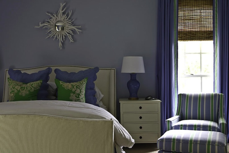 girl's rooms - purple walls white sunburst mirror linen wingback bed headboard nailhead trim purple lamp purple pillows green silk pillows ivory nightstand purple drapes green ribbon trim bamboo roman shades white green purple striped curvy chair ottoman