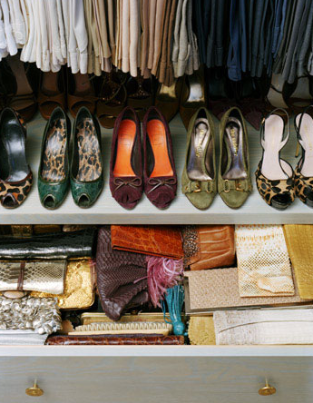 Suzie: Annie Schlecter Photography.  Fantastic closet with shoe rack and bag purse clutch drawer!