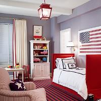 boy's rooms - blue walls red twin bed white red monogrammed bedding red blue striped rug red lantern pendant red white striped chair white cotton drapes red ribbon trim white bookcase