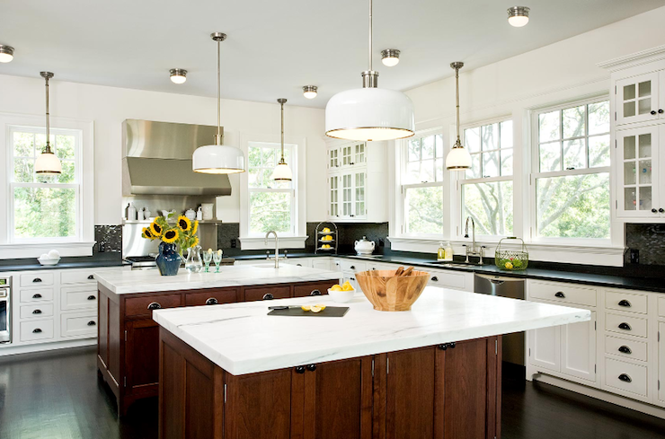 kitchens - white brown cabinets double kitchen islands calcutta marble countertops soapstone countertops pendants black glass tiles backsplash