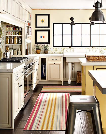 kitchens - ivory cabinets spice rack white carrara marble countertops black industrial pendants glossy yellow kitchen island white red yellow blue striped kitchen rug runner