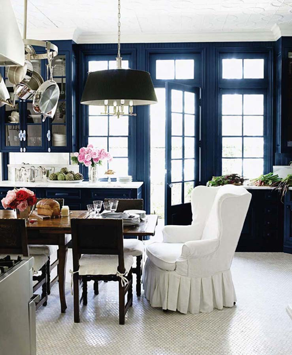 dining rooms - glossy blue walls hexagon white carrara marble tiles floor white wingback captain chair black tapered pendant pot rack rustic farmhouse dining table wood chairs cushions