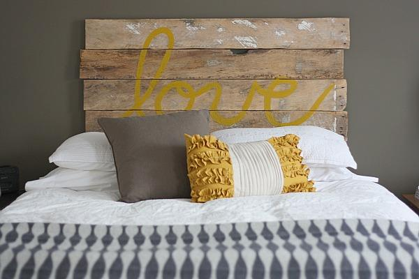 bedrooms - Sherwin Williams - Suitable Brown - gray brown walls rustic DIY Love headboard Ikea wool blue gray geometric throw taupe pillow yellow ruffled pillow