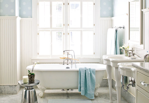 bathrooms - white beadboard plantation shutters claw foot tub white pedestal sink mirrors polished chrome modern stool blue wallpaper  Alexandra
