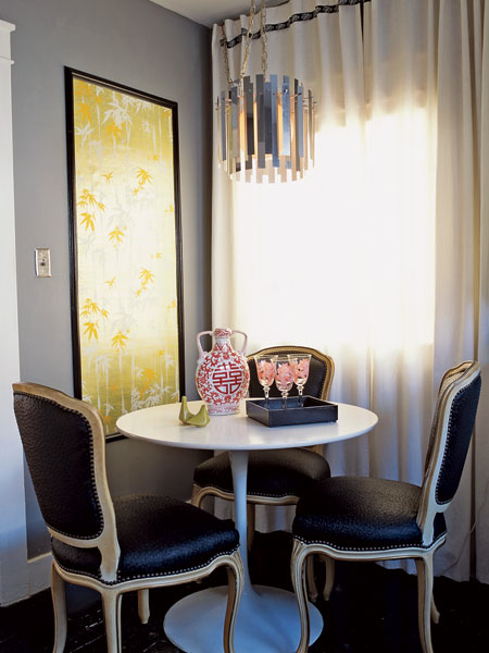 dining rooms - gray walls marble Saarinen table black leather nailhead trim French chairs white drapes yellow art glossy espresso wood floors