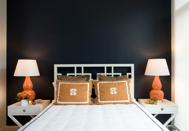 bedrooms - Williams Sonoma Home Hudson Table navy walls white overlapping squares headboard white hotel bedding gray stitching white x nightstands orange gourd lamps orange monogrammed pillows