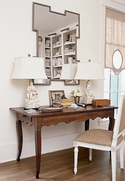 dens/libraries/offices - scalloped wood desk white chinoiserie lamps studded geometric mirror nailhead trim white chair linen back cushion linen window treatments