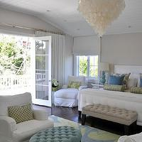 Giannetti Home - bedrooms - white, capiz, chandelier, gray, walls, beadboard ceiling, white, tufted, bed, blue, green, rug, blue, tufted, oval, ottoman, tan, tufted, bench, white, slipcovered chaise lounge, chairs, blue, gourd, lamp, green, bolster, pillows, blue, green, pillows, Oly Studio Serena Chandelier,