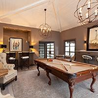 Gordon Gibson Construction - media rooms - game room, chic game room, vaulted ceiling, beadboard ceiling, beadboard vaulted ceiling, orb chandelier, milk chocolate walls, wet bar, directors bar stools, pool table, gray rug, gray built-ins, gray built in cabinets, chrome bar stools, modern chrome stools, cream chairs, cream tufted chairs, cream wingback chairs, cream tufted wingback chairs, hex table, hexagon table,