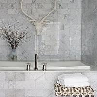 Pieces Inc - bathrooms - carrara marble, carrara marble bathroom, carrara marble tile, carrara marble tile bathroom, lucite ottoman, bathroom ottoman, imperial trellis ottoman, gray trellis ottoman, trellis ottoman, drop in tub, carrara marble drop in tub, marble tile floor, carrara marble tiled floor, carrara marble tiled walls, decorative antelope head,