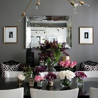 Erika Brechtel - dining rooms - Ralph Lauren - Mombasa Mist - gray dining room, gray paint colors, gray dining room paint colors, gray walls, gray dining room walls, mombasa mist, beveled mirror, diy lindsey adelman chandelier, gold chandelier, light bulb chandelier, modern chandelier, black dining table, rectangular dining table, rectangular black dining table, white dining chairs, open back dining chairs, white leather dining chairs, black dining table with white dining chairs, white dining chairs with black dining table, moroccan lantern, black moroccan lantern, mirrored tray, mirrored tiles tray, david hicks pillows, la fiorentina pillows, ballard deisgns chairs, black bamboo chairs, macau chair, black macau chair, black faux bamboo chair,