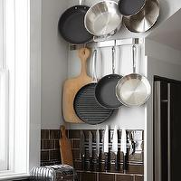 Urrutia Design - kitchens - brown subway tile, magnetic knife rack, pot rack,  URRUTIA DESIGN www.UrrutiaDesign.com Photography by Matt Sartain