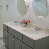 Ten June - bathrooms - Martha Stewart - Cement Gray - gray bathroom vanity, double vanity, gray double vanity, master bathroom, dual sinks, his and hers sink, crystal hardware, light countertops, light counters, oval mirrors, oval vanity mirrors, pivoting bathroom mirror, pivoting oval bathroom mirror, pivoting oval vanity mirror, marble tiled floors, marble floor tile, gray walls, gray bathroom walls, gray wall color, polished nickel bathroom sconces, polished nickel and white glass sconces, frosted glass sconce, cement gray, gray bathroom vanity, painted bathroom vanity, painted cabinets, painted bathroom cabinets, cream countertops, gray paint, gray paint colors, gray bathroom paint colors, gray washstand,