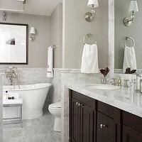 bathrooms - Benjamin Moore - Coastal Fog - marble tiled floor, marble walls, marble bathroom, basketweave marble tiled floors, basketweave accent tile, tiled rug, espresso stained vanity, double vanity, master bathroom, his and hers sinks, dual sinks, brushed nickel hardware, brushed nickel sconces, inset mirror, marble counters, marble countertops, towel loop, towel rack, freestanding, soaking tub, freestanding bath tub, wall mounted faucet, chrome based stool, bathroom stool, black and white framed photograph, gray walls, gray wall color, gray bathroom walls, coastal fog,