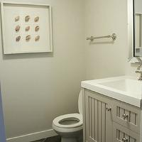 In the Fun Lane - bathrooms - Martha Stewart - Sharkey Gray - gray vanity, beadboard vanity, gray beadboard vanity, sink vanity with trough sink, trough sink, beveled mirror, mirror framed mirror, gray walls, gray wall color, gray bathroom walls, charcoal gray floor tile, herringbone tiled floors, dark gray herringbone tiled floors, charcoal gray herringbone patterned floors, brushed nickel towel rail, brushed nickel hardware, framed seashells, seashell shadow box, shadow box art, sharkey gray, Seal Harbor 30 in. Vanity in Sharkey Gray with Vanity Top in Alpine White, martha stewart vanity, martha stewart single vanity, martha stewart bathroom vanity, martha stewart beadboard vanity, slate tile, slate tile floor, slate floor, slate bathroom floor, slate herringbone, slate herringbone tile, slate herringbone floor, slate herringbone tile floor, slate herringbone bathroom floor,
