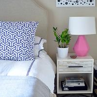 Stacy Graves - bedrooms: upholstered headboard, hotel bedding, hotel bedding with blue border, blue hotel bedding, blue throw, blue and white geometric pillows, cafe au lait wall color, cafe au lait walls, pink lamp, modern pink lamp, flokati rug, sheepskin rug, black and white art, black and white abstract art, linen colored upholstered headboard, arched upholstered headboard, jade plant, plant, folded blue throw, Delta Schiaparelli Pink High Table Lamp, Hong Kong Pillows, West Elm Wood Tiled Nightstand, pink geometric lamps,
