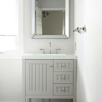 In the Fun Lane - bathrooms: gray vanity, gray sink vanity, beadboard vanity, gray beadboard vanity, sink vanity with trough sink, trough sink, beveled mirror, mirror framed mirror, gray walls, gray wall color, gray bathroom walls, charcoal gray floor tile, slate tile, slate tiel floor, slate floor, slate bathroom floor, towel rail, brushed nickel hardware, dark gray floor tile, dark gray tiled floors, brushed nickel triple sconce, brushed nickel bathroom sconce, sharkey gray, Seal Harbor 30 in. Vanity in Sharkey Gray with Vanity Top in Alpine White, martha stewart vanity, martha stewart single vanity, martha stewart bathroom vanity, martha stewart beadboard vanity,