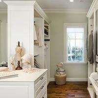 Designer Closets - closets: walk-in closet, closet storage, closet layout, closet island, island in closet, walk-in wardrobe, master closet, master bedroom closet, recessed lighting, pot lights, hardwood floors, baseboards, crown molding, clothes rails, ridged glass cabinets, ridged glass fronted cabinets, glass fronted cabinets, glass front cabinets, hardwood floors, white cabinets, clothes racks, closet shelves, built-in closet, closet design, gray walls, gray wall color, pull-out bins, pull-out shoe bins, pull-out sweater drawers, glass front cabinets, closet cabinets, glass front closet cabinets, glass front wardrobe cabinets,