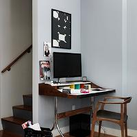 Marcus Hay - dens/libraries/offices - office nook, office in living space, danish mid-century chair, danish mid-century modern chair, chrome based wood topped desk, chrome based desk, black and white framed art, black and white modern art, gray blue walls, gray blue wall color, hardwood floors, small office space, office off stairs, desk off stairway, mid century modern desk,